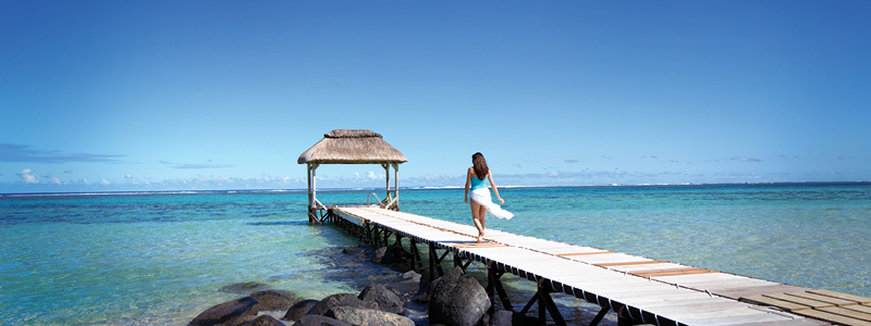 Lady on jetty | Outrigger Mauritius Beach Resort