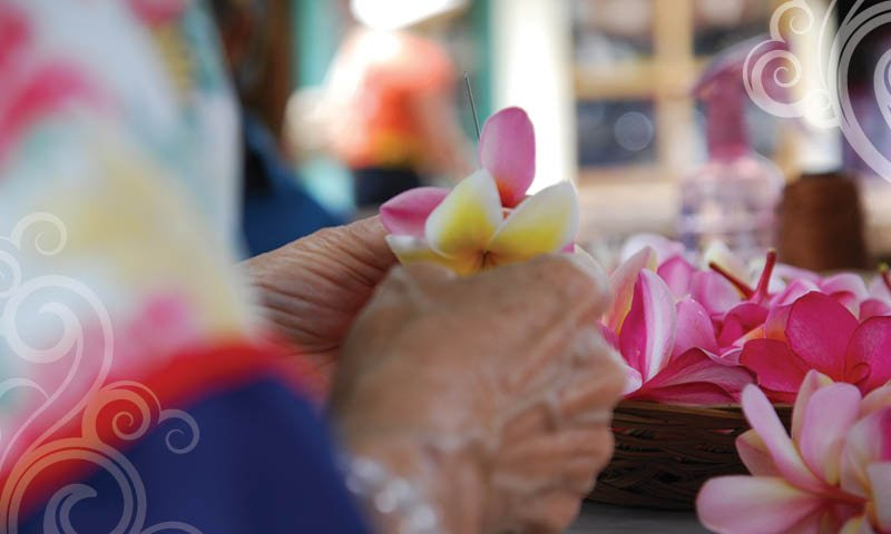 making lei with plumeria