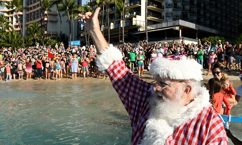Santa Shaka on Waikiki Beach from Canoe